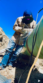 """Anthony welding on 24"""" pipe while working in Bowie, Texas."""